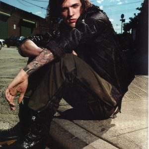 Male Model wears a Black Lost Art Python skin Jacket in INKED magazine