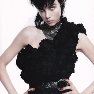 Model wearing a Lost Art Double Ring Python Belt in Vogue Paris Magazine