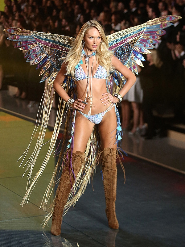 Supermodel Candice Swanepoel wears Lost Art leather wings and jewelry at the Victoria's Secret Fashion Show 2015